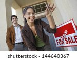 happy couple with keys to new... | Shutterstock . vector #144640367