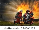 Firemen Using Extinguisher And...