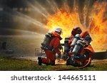 firemen using extinguisher and... | Shutterstock . vector #144665111