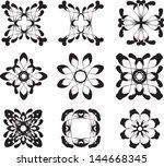 set of black flower symbols   Shutterstock .eps vector #144668345