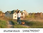Stock photo young woman walking her adorable brussels griffon dogs outdoors 1446790547