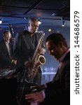 Small photo of Jazz musicians performing in the club