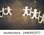 Small photo of Two paper human chains disconnect or loosing doll in a role of team, teamwork or connection concept