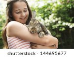 Happy Young Girl Holding Bunny...
