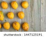 Spoiled Lemons On A Wooden...