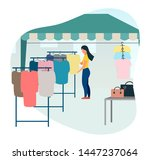 woman buying clothes at street... | Shutterstock .eps vector #1447237064