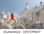 Burmese girl play and jumping on Mingun Mandalay Hsinbyume Pagoda Mandalay Myanmar, white temple Mandalay