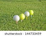 Four Golf Balls Placed On Thei...