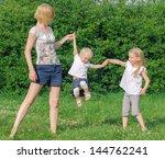 mother and her daughters having ...   Shutterstock . vector #144762241