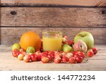 glass of juice with fruits   Shutterstock . vector #144772234