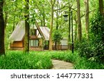 the house in the woods | Shutterstock . vector #144777331