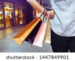 Small photo of Woman hanging shopping bags in her hand and acting hands on waist.