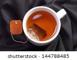 a cup of tea with tea bag on a... | Shutterstock . vector #144788485