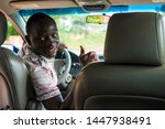 Black Male Driver Giving A...