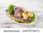 Stock photo russian cuisine in the form of potatoes with dill and herring in a white plate close up potatoes 1447973471