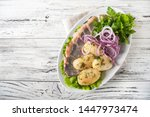 Stock photo russian cuisine in the form of potatoes with dill and herring in a white plate close up potatoes 1447973474