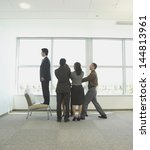 Small photo of Co-workers performing trust building exercise