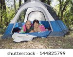 senior couple laying in tent... | Shutterstock . vector #144825799