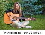 guitarist girl play music on... | Shutterstock . vector #1448340914