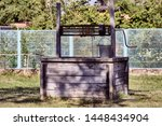 Old Wooden Well With A Rusty...