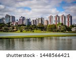 Barigui Park, Curitiba, Brazil. View of several buildings. Lake.
