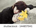Sad Young Woman Lying On The...