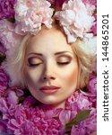 woman in peonies portrait of... | Shutterstock . vector #144865201