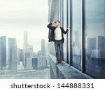 man standing on the edge and... | Shutterstock . vector #144888331