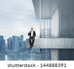 businessman sitting on the edge ... | Shutterstock . vector #144888391