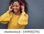 african girl listening to music ...   Shutterstock . vector #1449002741