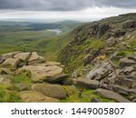 Small photo of Kinder Downfall overlooking Kinder Reservoir with the wind blowing the waterfall back into the air against dark storm clouds overhead, Peak District National Park, UK