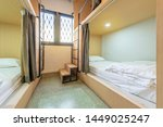 Stock photo hostel dormitory beds arranged in dorm room with white plain bunk bed in dormitory hotel dormitory 1449025247