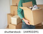 midsection of man carrying open ... | Shutterstock . vector #144903391
