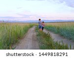 two boys walking on the field | Shutterstock . vector #1449818291