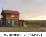 wooden house in field . | Shutterstock . vector #1449824501