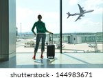 girl at the airport window | Shutterstock . vector #144983671