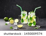 Two Cold Mojito In Jars With...