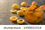spoon in a jar of apricot jam... | Shutterstock . vector #1450021514