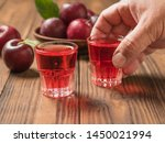 a glass of plum alcohol in a... | Shutterstock . vector #1450021994