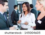 businesspeople interacting... | Shutterstock . vector #145004605