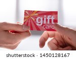 close up of female hand giving...   Shutterstock . vector #1450128167