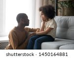 Small photo of Loving african American father talk with upset preschooler daughter helping with problem, caring black young dad speak with sad girl child holding caressing hand, show support and understanding
