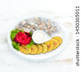 Stock photo herring with baked potatoes in the plate on a wooden background top view free space for your 1450305011
