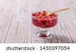 vase with cherry jam and a... | Shutterstock . vector #1450397054