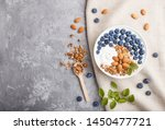 yoghurt with blueberry  granola ... | Shutterstock . vector #1450477721