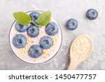 yoghurt with blueberry and... | Shutterstock . vector #1450477757