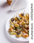 Stock photo salted herring on skewers with cheese and olives on plate 1450566944