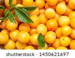 Small photo of yellow plum mirabelle close-up. Summer fruit season.harvest.