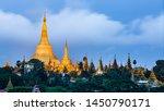 Small photo of Shwedagon Pagoda at morning in Yagon City with blue sky background, Shwedagon Pagoda is beautiful pagoda in Southeast Asia, Yangon skyline with Shwedagon Pagoda in Myanmar.