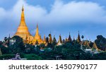 Small photo of Shwedagon Pagoda attraction at morning in Yagon City with blue sky background, Shwedagon Pagoda ancient architecture is beautiful pagoda in Southeast Asia, Yangon, Myanmar, Asian, Asia.